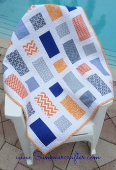 Baby Dean, blue and orange quilt, squares and rectangles, boy quilt