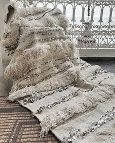 The most luxurious traditional wedding blanket handmade in Morocco.The history of handiras dates back to antiquity in Atlas Mountains where this blankets were worn by the bride on her wedding d...