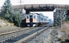 New Haven Railroad Budd RDC train is seen traveling along the Shore Line at milepost B36, near Pawtucket, Rhode Island and the Attleboro, Massachusetts border, late 1950's, Mac Seabree Collection