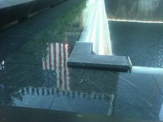 Took this picture of the American flag reflecting in the 9/11 Memorial fountain at Ground Zero.