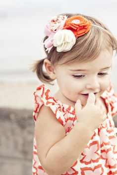 super adorable headband and dress... @ the link there are directions for how to sew the dress and it's really simple, looks like the dress Jessie just pinned.  it could be cute to have the flower girls in a fun pattern!