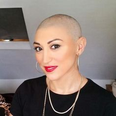 """This summer, Andrea Pellegrini, a makeup artist in London, was diagnosed with breast cancer, inspiring her to start a video blog, Baldly Beautiful.(Photo courtesy of Andrea Pellegrini) Early this summer, the most pressing thing on Andrea Pellegrini's mind was booking a family getaway for her upcoming 40th birthday.  """"My husband said to me, 'Why don't you set up a YouTube channel and help other ladies like yourself?'"""" Pellegrini said."""
