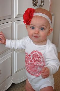 heart doily shirt- super easy cute valentines shirt! Just roll fabric paint on a paper doily and press onto the shirt!