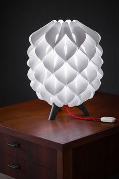 The Blom table lamp with Dark Birdseye legs and a red cord.  A modular lamp design inspired by the process of growth. Made by me in California, and assembled by you in about 20 minutes.