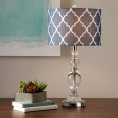 This crystal table lamp lights up the room with bold, exotic style.  The navy blue fabric shade features a Moroccan-inspired white trellis pattern.