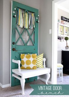 Create a beautiful and truly unique piece for your home using a vintage door, a wooden patio chair and some fresh paint. We love this palette of teal, yellow and white.