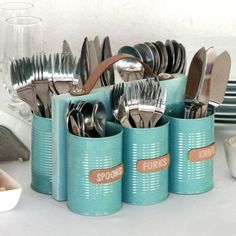 Use recycled cans to make a cutlery holder that can be used for indoor and outdoor entertaining. DIY cutlery storage.