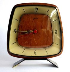 Just like ours!  Mid-century modern alarm clock - love the wood in the middle. #vintage