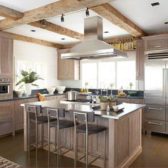 Stainless steel countertops can be found in any kitchen style. Other metal countertop materials include copper, pewter, and zinc, but those are more style-specific. Kitchen Cabinetry, Kitchen Countertops, Stainless Countertops, Soapstone Kitchen, Kitchen Hoods, Wood Cabinets, Kitchen Appliances, French Kitchen, Country Kitchen