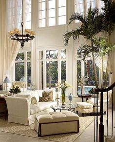 WINDOW TREATMENT INSPIRATION OF THE WEEK!  There is nothing more dramatic than two story rooms with soft billowy draperies. The tied back under-sheer creates the proper proportions for this tall window while keeping the air of casual elegance.