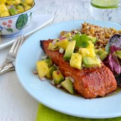 Chipotle Grilled Salmon w/ Pineapple Avocado Salsa- Dry rubbed, spicy-sweet salmon is topped with citrusy pineapple salsa with creamy avocado and spicy jalapeño!