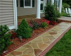 stained concrete walkway w/brick edging