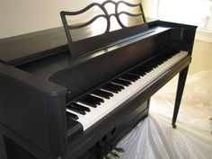 black painted piano.