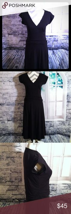 Gorgeous Lilla . P Black Dress A Gorgeous Lilla. P dress !! It's in great and excellent condition !! It feels and looks soft ;) !! Its sleeveless and has stretchy middle. The perfect dress for the fall!! It's stretchy and made out of 93% Cotton and 7% Spandex!! If any questions please ask ;) !! Lilla P Dresses Midi