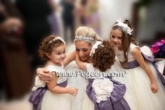 Euro Lilac and Petal Pink Tulle Flower Girl Dresses by Pegeen.com with 10 layers of tulle Available in 200 Colors. Call us for design help 407-928-2377