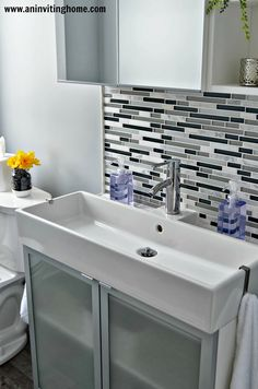 Love the sink, great idea for more than one kid to wash at one time--Family Bath Modern Update via Remodelaholic.com