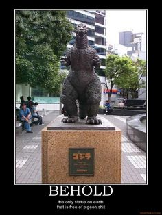 demotivational poster: Behold the only statue in the world free of pigeon shit