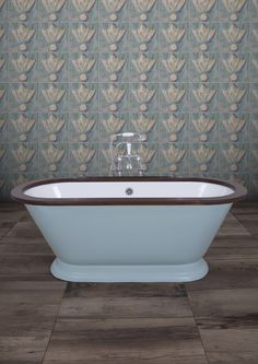 """Our brand new bath! The stunning Montpellier, which features an impressive depth as well as a charming shape and curves. Available in any paint colour, it is seen here in Farrow and Balls """"Ball Blue Ground"""" paint, and is finished off with either a mahogany or oak wooden roll! #bath #castiron #mahogany #oak #bathroom #decor"""