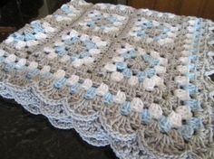 This is a sure to be treasured baby shower gift for the new mom and modern baby boy! It is crafted from gray, blue and white 100% acrylic super soft yarn!! This granny square afghan measures either 26 x 31 or 31 x 31 - the choice is yours at checkout :)approximately. It is easily laundered by either hand or machine washing in cold water on the delicate/gentle cycle and either laying flat to dry or tumble drying on low.  Like this item?! Check out some more of my homemade creations at:  h...
