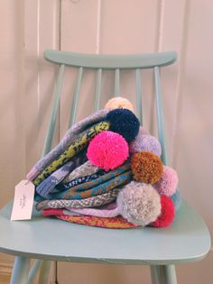 Knit hats with pompoms in yummy colors by Kutova Kika