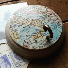 Use this map decorated hook to hang up your favorite belongings.