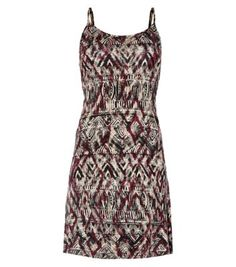 Tribal prints are great for making a statement this season. Accessorize this cami dress with a black waist belt and gladiator sandals. #nlfashion #dresses #tribal #print #camidress #cami