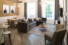 Minoli Tiles - Harefield - Tree-Age Grey, wood effect porcelain tile. This fantastic warehouse refurbishment was design with Tree-Age Grey 10/70, a wood look porcelain tile in a herringbone layout. https://www.minoli.co.uk/tiles/tree-age-grey/ - #Minoli #minolitiles #porcelain #tile #porcelaintile #tiles #porcelaintiles #woodlook #woodeffect #treeage #grey #matt #livingidea #kitchenidea #herringbone #homedecor #interiordesign