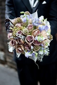 Beautiful muted mauve and lavender tones, starring Amnesia roses.