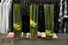 Flax leaves with orchids; sleek and contemporary. Creative Flower Arrangements, Contemporary, Modern, Orchids, Leaves, Candles, Floral, Flowers, Trendy Tree