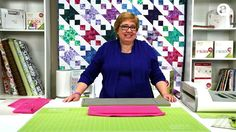 Erica shows how easy it is to cut bias binding quickly and accurately with up to six layers of fabric on your AccuQuilt GO! Strip Cutter dies.