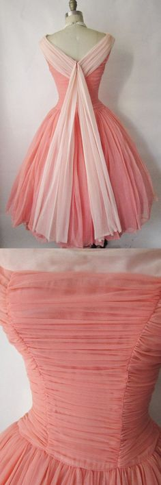 Pleated Knee-length A-line Tea Dress in Coral.  This is just a darling little dress. The pleats are adorable and the sash at the back completes the look. I would wear this little cute dress anywhere. Evie Miller