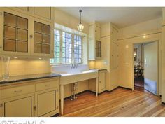 well-preserved kitchen in 1930s Norman Tudor estate in the heart of Emerywood designed by Luther Lashmit (Graylyn Mansion & Adamsleigh) | North Carolina