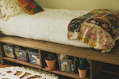 Under the bed shelving is a very cute and creative bedroom storage idea. This is also one of those diy small bedroom storage ideas that saves a ton of wall space for paintings and other wall hangings that you may want to put on your wall. Having storage under your bed rather than on the walls is also perfect for if you have cats or other animals that may knock items off of higher shelves.