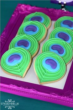 peacock feather cookies - the cookies are cute, but the way they are being served is awesome!  I never would have thought to serve on a frame like that.  Love it.
