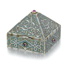 A Fabergé silver and enamel box, Moscow, 1899-1908, square with pyramid-form lid, the surfaces cast and chased with entwining stems, stylised flowerheads and scrolls on a matte pale turquoise enamel ground, the lid and sides centred with cabochon rubies.