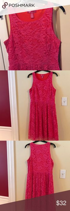 Adorable Lace Skater Dress Very cute junior skater style dress. Fushia lace (60%cotton/40% poly) over tomato red lining (100% poly). Side zip under left armhole. Worn once - great condition but with very minor pilling on hem. Ultra Pink Dresses Prom