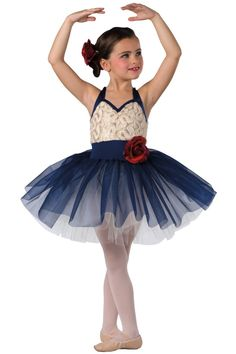 Style#  17172 PROMISES  Navy and ivory spandex halter leotard with sequined ribboned mesh overlay. Attached navy glimmer chiffon over ivory tulle tutu. Flower trim. Headpiece included. XSC-XLC