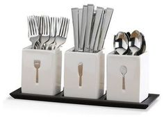 contemporary flatware by Mikasa  Blakely 36 Piece Flatware Set w/Caddies - $79.99 »    The cutlery pressed in each ceramic caddy adds style to a stereotypically ordinary container. The design promotes organization as well.