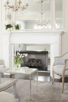 Leo Designs Chicago - living rooms - French living room, inset mirror, fireplace mirror, mirror fireplace surround, mirrored fireplace surround - Model Home Interior Design French Country Living Room, Living Room With Fireplace, Living Room Designs, French Living Rooms, Fireplace Mirror, Country Living Room Design, Fireplace Surrounds, Country Living Room, Front Room Design
