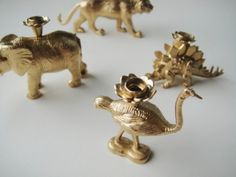 Gold Animal Candle Holders - Just a couple of plastic animals, some golden spray paint, a drill and a plastic candle holder to stick on top. Finish them with a few coats of paint