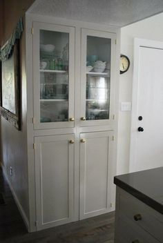 White Inset Kitchen Cabinets Built Into The Wall. It Looks Like A Hutch  With Glass