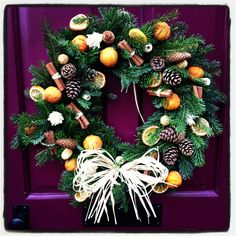 Love this wreath and the eggplant color door!