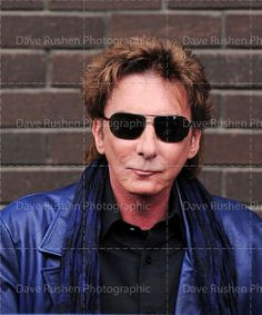 Barry Manilow wearing shades.