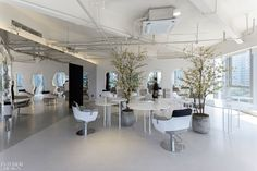 "The mirrors against the building's original walls reflect a collage of old and new elements. Inspired by the Soviet fantasy film ""Kingdom of Crooked Mirrors,"" interior design studio Atelier Right Hub positioned the waiting area and various salon chairs along the different sides of the structure, which also features a coffee counter. #InteriorDesign #HospitalityDesign #SalonDesign"