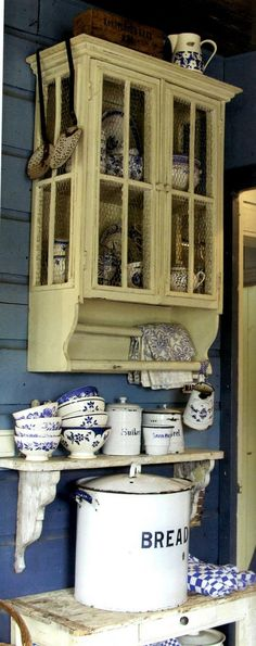 Love the cupboard!! Over the counter by the sink on the left for the coffee/tea station. In shabby finish blue to match the rest of the kitchen.