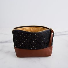 Better than Mistletoe: Gifts She'll Adore – CarpenterHill.com  On Point Cosmetic Bag  The gorgeous On Point Cosmetic Bag makes packing all of your cosmetics simple. The two inner pockets keep you organized and the canvas lining makes it easy to clean. Available in two fabrics.