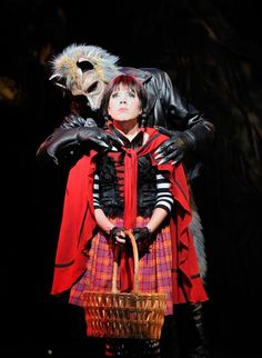 Hello Little Girl sings the Wolf (played by Derrick Cobey) to a frightened Little Red Ridinghood (portrayed by Erin Childs) in the Great Lakes Theater Festival production of Stephen Sondheim's enchanting musical Into the Woods.