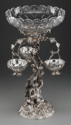 75079: An English Victorian Silver-Plated Figural Epergne with cut-glass bowls, circa 1880