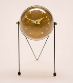 Anonymous; Enameled Steel and Perspex Table Clock, 1950s.