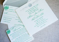 Letterpress invitation suite in kelly green and silver with sand dollar flourish.